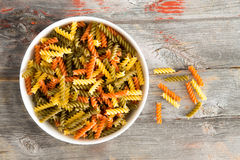Colourful bowl of tomato and spinach fusilli pasta Stock Images