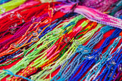 Colourful bracelets Stock Photos