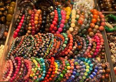 Colourful bracelets on market's stand. Hong Kong. Royalty Free Stock Photos