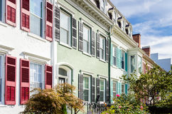 Colourful Brick Row Houses under Blue Sky with Clouds. Pastel Coloured Brick Row Houses with Colourful Shutters in Geneva, NY Stock Images