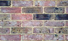 Colourful Brick Wall Background. An old colourful brick wall makes an ideal background or wallpaper Stock Photography