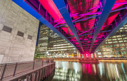 Colourful bridge at night in Canary Wharf, London.  Royalty Free Stock Photography