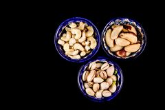 Colourful bright East style plates with different nuts royalty free stock photos
