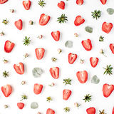 Colourful bright pattern made of strawberries, pink rose buds Stock Photos