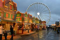 Winter Wonderland Christmas fairground Hyde Park. Colourful brightly lit amusement houses and ferris wheel in Winter Wonderland Christmas themed fairground in Royalty Free Stock Photography