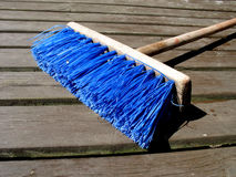 Colourful broom. When the dust is to go Royalty Free Stock Photo