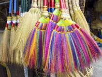 Colourful brooms Stock Images