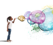 Colourful bubble. Little girl makes big colorful soap bubbles Stock Photos