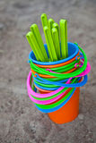 Colourful buckets on a sandy beach Royalty Free Stock Photography