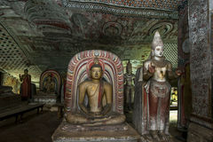 Colourful Buddha statues in one of the caves at Dambulla Cave Temples in Sri Lanka. Stock Photos