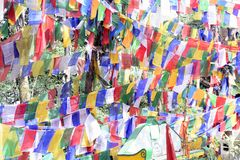 The colourful buddhist prayer flags flying high in the sky royalty free stock photos