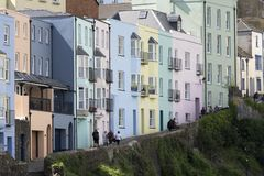 Colourful buildings in Tenby, Pembrokeshire, South Wales. A row of pastel coloured terraced houses and apartments lead up a hill in Tenby, coastal town in Stock Photography