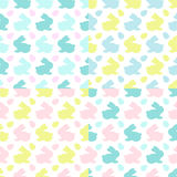 Colourful Bunnies silhouettes patterns. A set of four vector seamless pattern with colourful easter bunnies silhouettes on the white background Royalty Free Stock Image