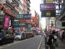 A colourful busy street in Mong Kok, Hong Kong royalty free stock photography