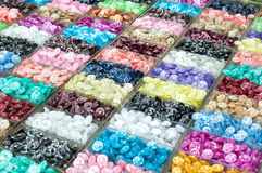 Colourful buttons on display at a market stall Stock Photography