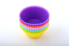 Colourful cake molds Stock Photos