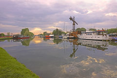 Colourful canal barges and boats at Saul Junction in Spring, England, UK Royalty Free Stock Photos