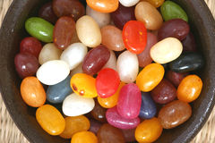 Colourful candies in a brown bowl Stock Photography