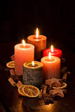 Colourful Candles. Burning with christmas decoration Royalty Free Stock Photography