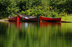 Colourful canoes. Around the portage Royalty Free Stock Image