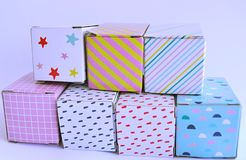 Colourful cardboard boxes on white background. Seven colourful and patterned cardboard boxes on a white background Royalty Free Stock Image