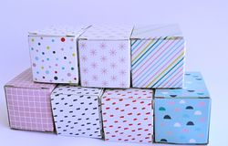 Colourful cardboard boxes on white background. Seven colourful and patterned cardboard boxes on a white background Royalty Free Stock Photography