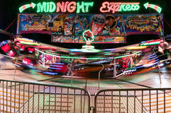 Colourful carnival ride at night stock photo