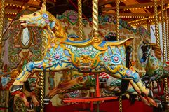 Colourful carousel horse at the pier Stock Photos