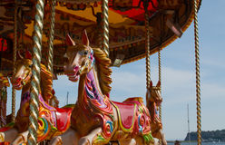 Colourful Carousel Horses. Three colourful Carousel Horses at a fairground Stock Photography