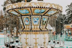 Colourful carousel in the winter Park royalty free stock images