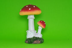Colourful ceramic mushroom isolated in green background. Equipped with artificial grass Stock Photography