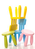 Colourful chairs stacked Stock Photography