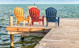 Colourful chairs at sunset with ocean view Stock Photo