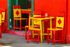 Colourful chairs and tables. Colourful chairs in front of a building in El Jardin Antioquia Colombia Stock Photos