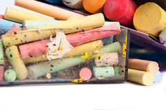 Colourful chalks in a box Stock Photos