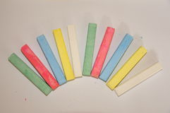 Colourful Chalks. Green, red, blue, yellow and white Royalty Free Stock Photos
