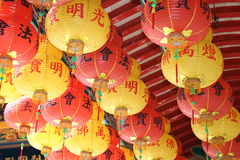 Colourful Chinese paper lanterns. Colourful paper lanterns hanging from the roof of a Chinese temple royalty free stock photos