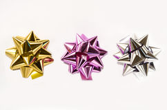 Colourful Christmas bows. Three colourful gift bows on the white background Stock Image