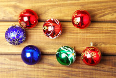 Colourful christmas bubbles. On wooden background royalty free stock photos