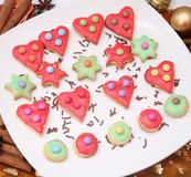 Colourful christmas cookies. Some colourful christmas cookies on a plate Royalty Free Stock Photography