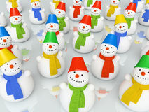 Colourful christmas snowmans in scarfs on skating rink. 3D royalty free stock photos