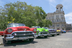 Colourful classic cars in Havana, Cuba. A series of classic american cars serving as taxi for tourists in Old Havana stock photo