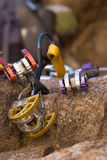 Colourful climbing gear. Colourful climbing ultralight Spring-Loaded Camming Device ( SLCD ) protection gear made of aluminium and steel alloys. Arranged on rock royalty free stock images
