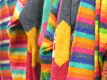 Colourful Clothes. A selection of bright colourful jumpers for sale Royalty Free Stock Images