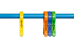 Colourful clothes pegs Stock Photography
