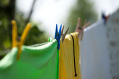 Colourful Clothespins. Linen hanged by different colourful clothespins Stock Photo