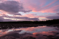 Colourful cloud and reflection in sunset Stock Photos