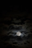 Colourful clouds chasing the moon Stock Image