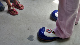 Colourful clown shoes  and girl sandle Stock Images