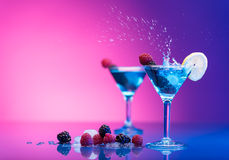 Colourful cocktails garnished with berries Royalty Free Stock Image